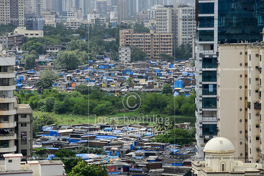 INDIA, Mumbai, skyscraper  and slum huts in suburb Goregoan