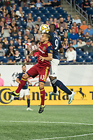 FOXBOROUGH, MA - SEPTEMBER 21: Justin Portillo #43 of Real Salt Lake and Juan Fernando Caicedo #9 of New England Revolution compete for a high ball during a game between Real Salt Lake and New England Revolution at Gillette Stadium on September 21, 2019 in Foxborough, Massachusetts.