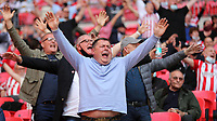 Brentford fans celebrate winning the Championship Trophy and promotion to the Premier League during Brentford vs Swansea City, Sky Bet EFL Championship Play-Off Final Football at Wembley Stadium on 29th May 2021
