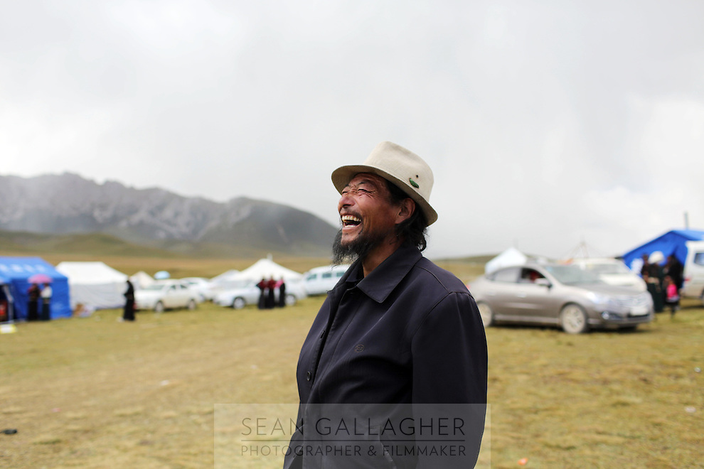 A Tibetan man laughing during a festival on the Tibetan Plateau, in western China.