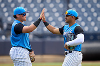 Tampa Tarpons outfielder Jasson Dominguez (20) high fives third baseman Andres Chaparro (24) after a game against the Lakeland Flying Tigers on July 18, 2021 at George M. Steinbrenner Field in Tampa, Florida.  (Mike Janes/Four Seam Images)