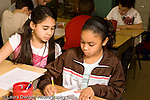 Education Elementary school Grade 4 science special two girls working together on graph project horizontal