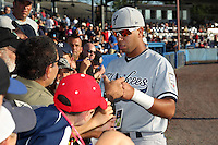 Staten Island Yankees shortstop Cito Culver #2 signs autographs before a game against the Batavia Muckdogs at Dwyer Stadium on July 29, 2011 in Batavia, New York.  Staten Island defeated Batavia 10-7.  (Mike Janes/Four Seam Images)