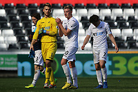 SWANSEA, WALES - MARCH 25: Gregor Zabret of Swansea City Adam King of Swansea City and Daniel James of Swansea City applauds the fans after the final whistle of the Premier League International Cup Semi Final match between Swansea City and Porto at The Liberty Stadium on March 25, 2017 in Swansea, Wales. (Photo by Athena Pictures)Athena Pictures)