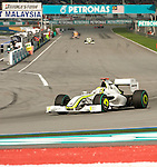 05 Apr 2009, Kuala Lumpur, Malaysia ---   Brawn GP Formula One Team driver Jenson Button of Great Britain leads the pack during the 2009 Fia Formula One Malasyan Grand Prix at the Sepang circuit near Kuala Lumpur. Photo by Victor Fraile --- Image by © Victor Fraile / The Power of Sport Images
