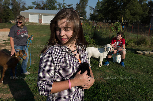 Lowell, Arkansas<br /> Darla Anderson with her children, Meghan, 18, and Ben, 14, and their project animals, two goats and a rabbit. Meghan is president of her school's Future Farmers of America program and Ben is also a member.