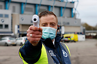 21st November 2020; The Den, Bermondsey, London, England; English Championship Football, Millwall Football Club versus Cardiff City; Safety Steward scanning temperatures of permitted visitors outside The Den Stadium before kick off
