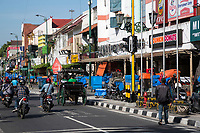 Yogyakarta, Java, Indonesia.  Malioboro Street.  Many vendors' stands are covered in blue or orange plastic, not yet open for the day.