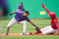 Fort Myers Mighty Mussels second baseman Ruben Santana (1) tags Jadiel Sanchez (16) sliding in during a game against the Clearwater Threshers on July 29, 2021 at BayCare Ballpark in Clearwater, Florida.  (Mike Janes/Four Seam Images)