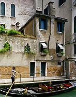 A gondolier propels his vessel passed Lars Rachen's Venetian apartment