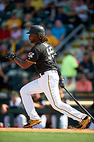 Pittsburgh Pirates first baseman Josh Bell (55) follows through on a swing during a Spring Training game against the Tampa Bay Rays on March 10, 2017 at LECOM Park in Bradenton, Florida.  Pittsburgh defeated New York 4-1.  (Mike Janes/Four Seam Images)