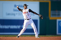 Lansing Lugnuts shortstop Richard Urena (1) throws to first during a game against the Peoria Chiefs on June 6, 2015 at Cooley Law School Stadium in Lansing, Michigan.  Lansing defeated Peoria 6-2.  (Mike Janes/Four Seam Images)