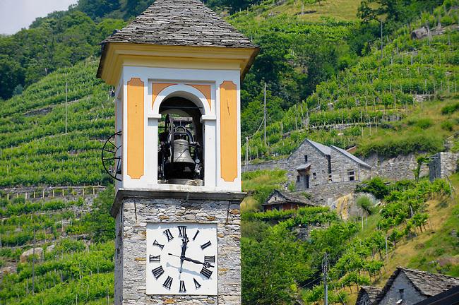 Para gliders over the rustic alpine village of Vogorno , Val Verzasca, Tocino Switzerland