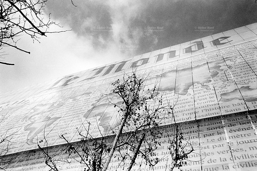 """France. Ile-de-france Department. Paris. Building's front of the newspaper """"Le Monde"""", 80 Boulevard Auguste Blanqui, 7th arrondissement. A view on the world and the planet Earth. Sentences written on the facade. 23.02.05 © Didier Ruef"""