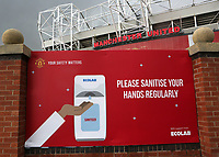 General view of a large sign on the approach to Old Trafford which reads, please sanitise your hands regularly, as football clubs continue to observe the Covid guidelines during Manchester United vs Brentford, Friendly Match Football at Old Trafford on 28th July 2021