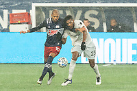 FOXBOROUGH, MA - NOVEMBER 1: Teal Bunbury #10 of New England Revolution and Donovan Pines #23 of DC United battle for the ball during a game between D.C. United and New England Revolution at Gillette Stadium on November 1, 2020 in Foxborough, Massachusetts.
