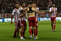 Olympiakos players celebrate the third goal of their team from Ranđelović (C) during the UEFA Champions League playoff first leg soccer match between Olympiakos and Krasnodar at Karaiskaki stadium in Piraeus, Greece, on 21 August 2019