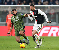 Calcio, Serie A: Juventus - Cagliari, Turin, Allianz Stadium, January 6, 2020.<br /> Juventus' Adrien Rabiot (l) in action with Cagliari's Paolo Farago (r) during the Italian Serie A football match between Juventus and Cagliari at Torino's Allianz stadium, on January 6, 2020.<br /> UPDATE IMAGES PRESS/Isabella Bonotto