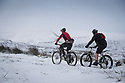 26/11/17<br /> <br /> Justin Saunders (red jersey) and Richard Badger brave an early morning snowy mountain bike ride on Axe Edge Moor on the Cheshire, Derbyshire borders high up in the Peak District.<br />  <br /> All Rights Reserved F Stop Press Ltd. +44 (0)1335 344240 +44 (0)7765 242650  www.fstoppress.com