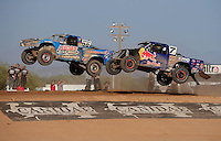 Apr 17, 2011; Surprise, AZ USA; LOORRS driver Robby Woods (99) leads Bryce Menzies (7) during round 4 at Speedworld Off Road Park. Mandatory Credit: Mark J. Rebilas-