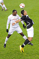Andre Sharpe (11) of the Cincinnati Bearcats and Marc Cintron (9) of the Providence Friars go up for a header. The Providence Friars defeated the Cincinnati Bearcats 2-1 during the semi-finals of the Big East Men's Soccer Championship at Red Bull Arena in Harrison, NJ, on November 12, 2010.