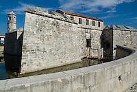 Moat and ramparts of the Castillo Real de la Real Fuerza on Plaza de Armas, Havana, Cuba.