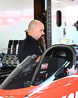 Feb 8, 2015; Pomona, CA, USA; A crew member for NHRA top fuel driver Leah Pritchett during the Winternationals at Auto Club Raceway at Pomona. Mandatory Credit: Mark J. Rebilas-
