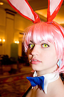 """Melanie McShane, cos-playing as Haruko Haru Haru, at the 12th annual Katsucon, a convention for fans of Japanese comics (manga), animation (anime), and video games, held in Washington D.C. on February 18, 2006 and attended by over 8,000 people.<br /> <br /> Cosplay, short for """"costume play"""", is the act of creating and wearing outfits of one's favorite anime, comic, or video game and often acting out that characters actions."""