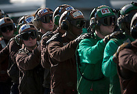 111207-N-DR144-091 PACIFIC OCEAN (Dec. 7, 2011) Aviation Machinist's Mate Airman Katie Griffith, assigned to Strike Fighter Squadron (VFA) 22, and other Sailors stand by to relieve hose team members during flight deck firefighting drills aboard Nimitz-class aircraft carrier USS Carl Vinson (CVN 70). Carl Vinson and Carrier Air Wing (CVW) 17 are currently underway on a Western Pacific deployment.  (U.S. Navy photo by Mass Communication Specialist 2nd Class James R. Evans/Released).