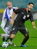 Clint Dempsey (8) tries to maintain possession against Robert Vittek (11). Slovakia defeated the US Men's National Team 1-0 at the Tehelne Pole in Bratislava, Slovakia on November 14th, 2009.