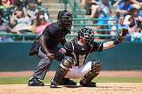 Hickory Crawdads catcher Matt Whatley (19) sets a target as home plate umpire James Jean looks on during the game against the Charleston RiverDogs at L.P. Frans Stadium on May 13, 2019 in Hickory, North Carolina. The Crawdads defeated the RiverDogs 7-5. (Brian Westerholt/Four Seam Images)