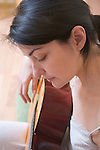 Russia, Voronezh, Woman playing guitar