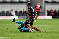 16th April 2021; Bankwest Stadium, Parramatta, New South Wales, Australia; A League Football, Western Sydney Wanderers versus Brisbane Roar; Jamie Young of Brisbane Roar dives to make a save at the feet of Bruce Kamau of Western Sydney Wanderers
