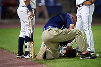 A Binghamton Rumble Ponies player is checked out by the trainer during a game against the Altoona Curve on May 17, 2017 at NYSEG Stadium in Binghamton, New York.  Altoona defeated Binghamton 8-6.  (Mike Janes/Four Seam Images)