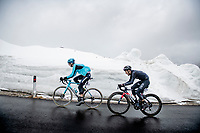 Aleksandr Vlasov (RUS/Astana - Premier Tech) & Daniel Felipe Martínez (COL/INEOS Grenadiers) coming over the Passo Giau<br /> <br /> due to the bad weather conditions the stage was shortened (on the raceday) to 153km and the Passo Giau became this years Cima Coppi (highest point of the Giro).<br /> <br /> 104th Giro d'Italia 2021 (2.UWT)<br /> Stage 16 from Sacile to Cortina d'Ampezzo (shortened from 212km to 153km)<br /> <br /> ©kramon