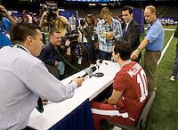 Alabama quarterback AJ McCarron talks with the reporters during BCS Media Day at Mercedes-Benz Superdome in New Orleans, Louisiana on January 6th, 2012.