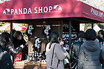 Visitors buy souvenirs of new giant panda cub Xiang Xiang at Tokyo's Ueno Zoo on December 19, 2017, Tokyo, Japan. The new female panda cub Xiang Xiang, born June 12, 2017, is being shown to the public for the first time. More than one thousand visitors are expected to come to see the panda on the day of her public debut. (Photo by Rodrigo Reyes Marin/AFLO)