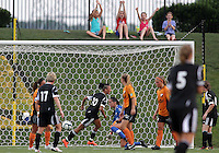 BOYDS, MARYLAND-JULY 07,2012:  Lianne Sanderson (10) of DC United Women turns away after beating Ashley Daniels (12) of Dayton Dutch Lions for the first goal during a W League game at Maryland Soccerplex, in Boyds, Maryland. DC United women won 4-1.