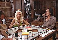 Hugh Hefner and girlfriend Karen Christy play Monopoly at Hefner's Chicago Mansion. 1973. Photo by John G. Zimmerman.