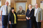 Artist Liz Nordstrom poses with her husband and Dean Winnie Brownell by the recently relocated portrait of Senator John O. Pastore in the lobby of Pastore Hall  on the Kingston campus of the University of Rhode Island n South Kingstown, RI on Thursday April 10, 2014. (Joe Gibln)
