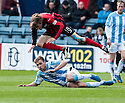 Dundee's Greg Stewart goes in late on St Johnstone's Murray Davidson.