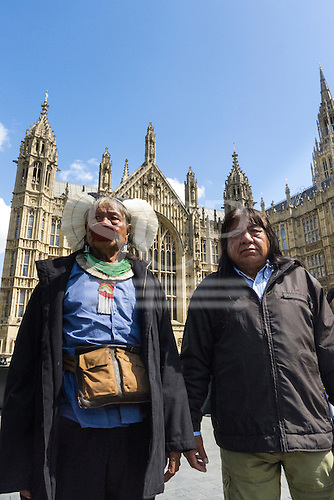 11 June 2014. Kayapo Chiefs Raoni Metuktire and Megaron Txucarramae during their visit to London. The chiefs stand in front of the British Houses of Parliament in Westminster.