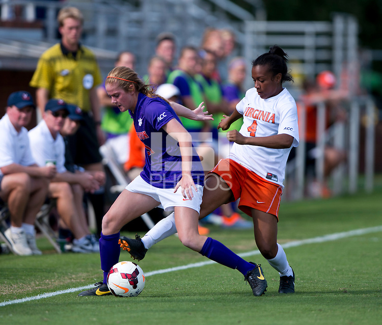Morgan Stith (4) of Virginia tries to poke the ball away from Abby Jones (21) of Clemson at Klockner Stadium in Charlottesville, VA.  Virginia defeated Clemson, 3-0.
