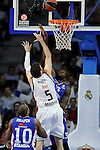 Real Madrid´s Rudy Fernandez and Anadolu Efes´s Stephane Lasme during 2014-15 Euroleague Basketball Playoffs second match between Real Madrid and Anadolu Efes at Palacio de los Deportes stadium in Madrid, Spain. April 17, 2015. (ALTERPHOTOS/Luis Fernandez)