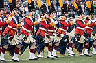 November 17, The Irish Guard leads the band on the field before the Shamrock Series football game against Syracuse in Yankee Stadium, New York. (Photo by Barbara Johnston/University of Notre Dame)