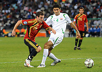 Juan Manuel Mata (left) of Spain and Fareed Majeed (right) of Iraq. Spain defeated Iraq 1-0 during the FIFA Confederations Cup at Free State Stadium, in Mangaung/Bloemfontein South Africa on June 17, 2009.