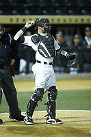 Wake Forest Demon Deacons catcher Shane Muntz (11) on defense against the Florida State Seminoles at David F. Couch Ballpark on March 9, 2018 in  Winston-Salem, North Carolina.  The Seminoles defeated the Demon Deacons 7-3.  (Brian Westerholt/Four Seam Images)