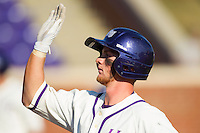Spencer Angelis (11) of the High Point Panthers high fives a teammate during the game against the Bowling Green Falcons at Willard Stadium on March 9, 2014 in High Point, North Carolina.  The Falcons defeated the Panthers 7-4.  (Brian Westerholt/Four Seam Images)