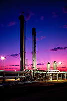 A power plant at sunset.