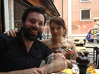 BNPS.co.uk (01202 558833).Pic: BNPS..Chloe Mayo and husband Michael..Artist Chloe Mayo painted a picture of her perfect husband before setting eyes on an identical real-life version of the man she has married...Chloe, 31, created the prophetic image of a herself holding hands with a male partner who had a dark beard...She forgot about the hastily-painted picture and weeks later joined an online dating website...Chloe spent two months messaging Michael Goeman, 30, through the singles site before meeting him face to face...After dating for six weeks Chloe thought Michael's face looked familiar and then remembered her painting and realised he was the spitting image of the man she painted...Because the oil painting was so uncannily similar to Michael, she hid the canvas under her bed in fear he thought she may have been stalking him...When she finally revealed the image to him a week later he was stunned at the resemblance, but to her relief he was not put off and actually proposed 18-months later...The couple were married at a ceremony near their home in May 2012 and have proudly hung the painting up in their lounge in Worcester Park, near Croydon in Surrey..